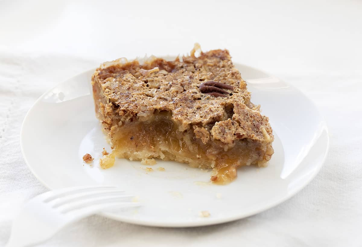 One Pecan Pie Bar on White Plate with White Fork