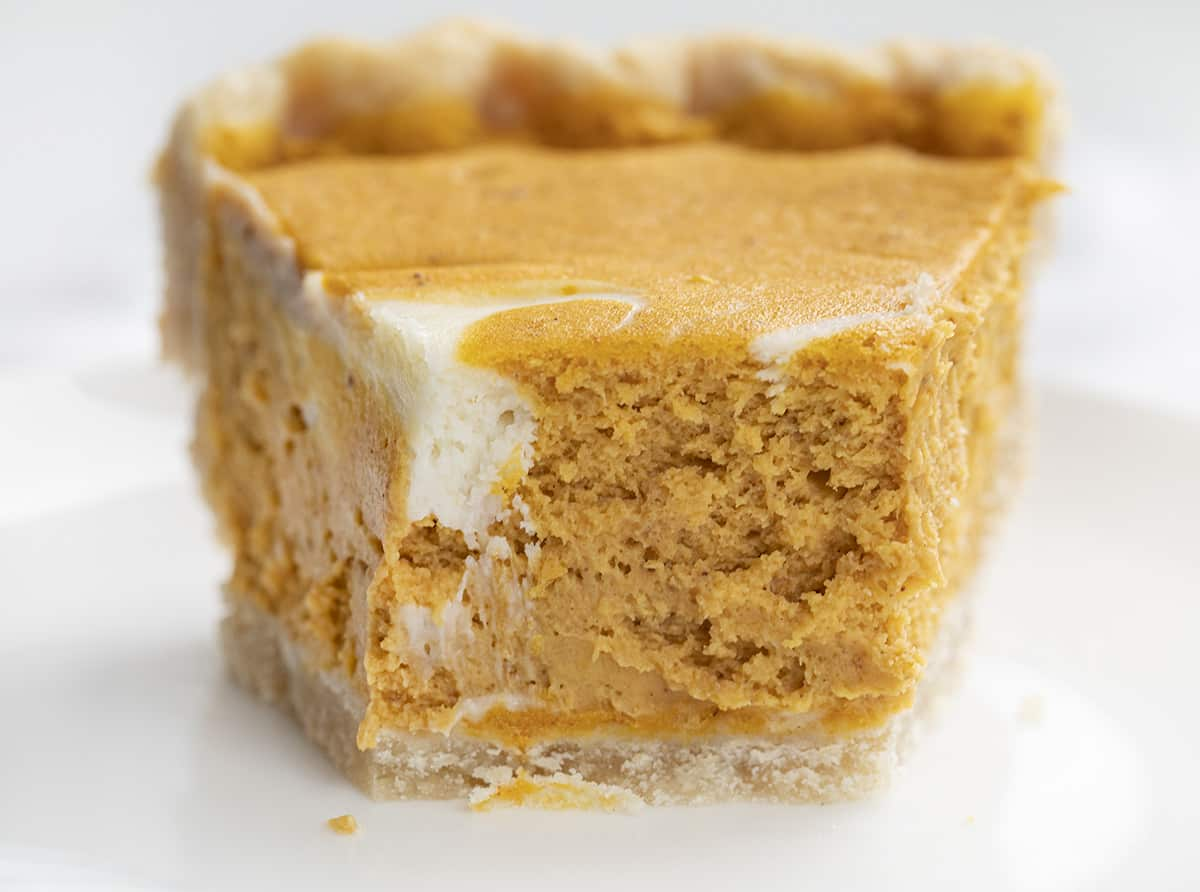 Pumpkin Cream Cheese Pie Slice with Bite Removed Showing Inside Texture