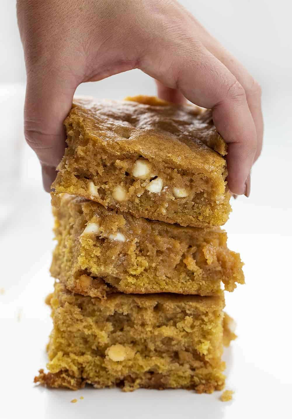 Handing Picking up Pumpkin Spice Snack Cake that is Stacked
