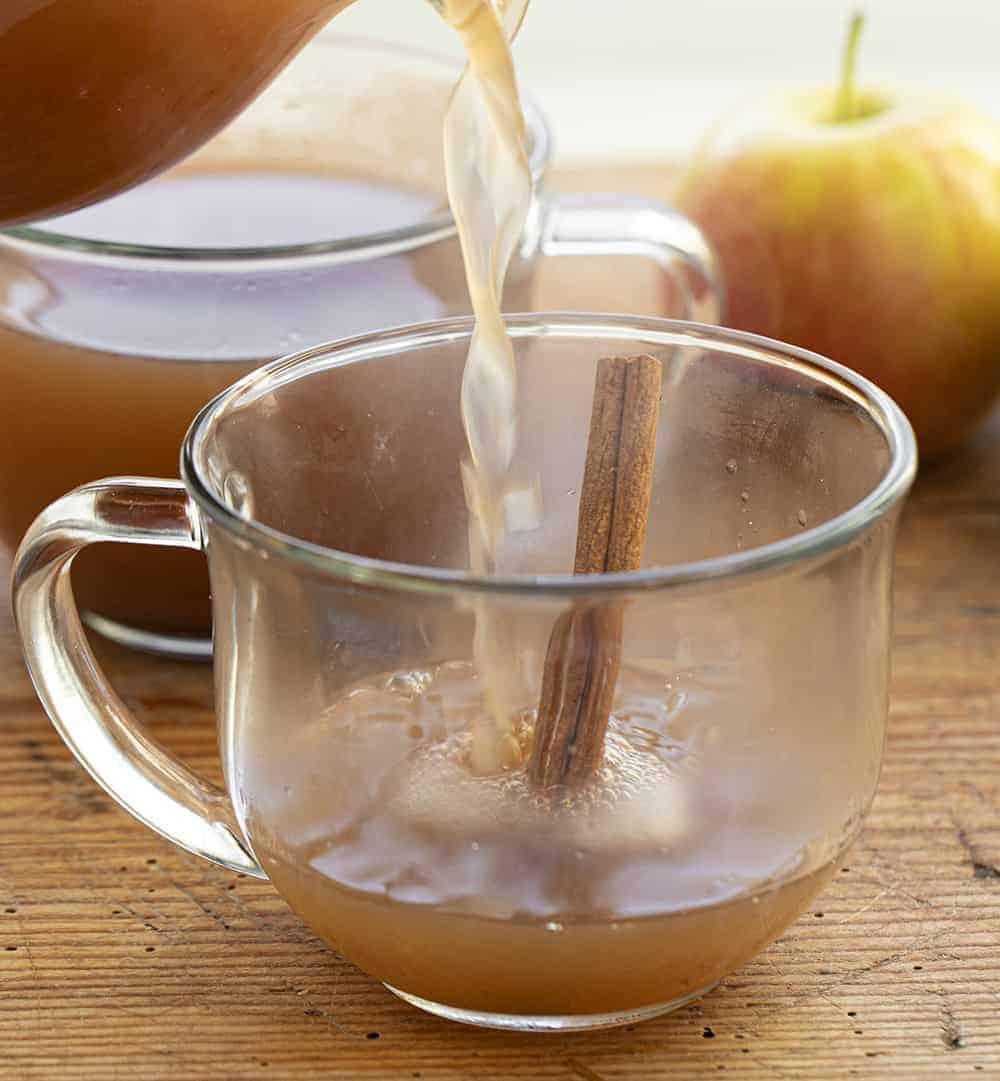 Pouring Apple Cider into Mug