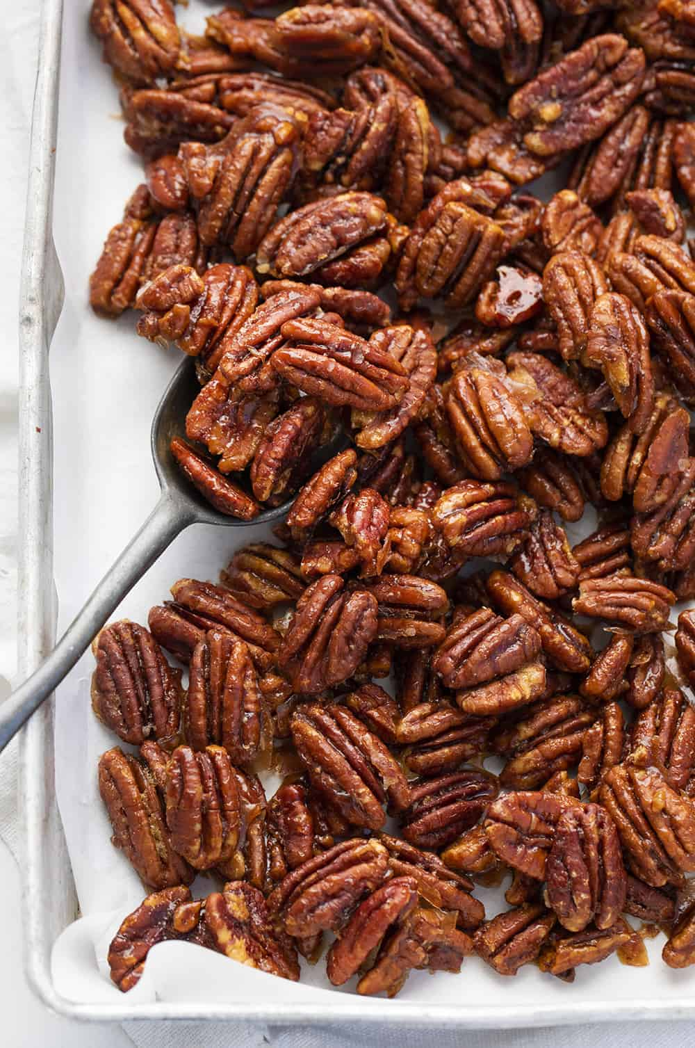 Overhead of Candied Pecans in Pan with Spoon