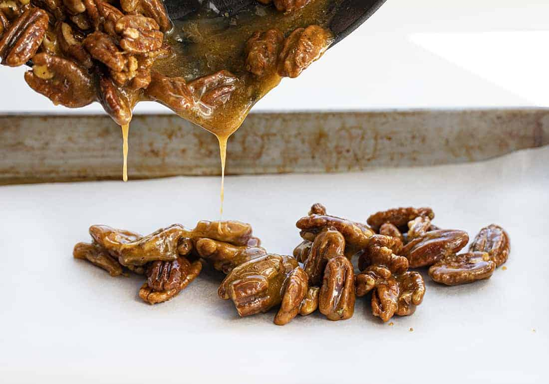 Candied Pecans Poured onto Sheet Pan