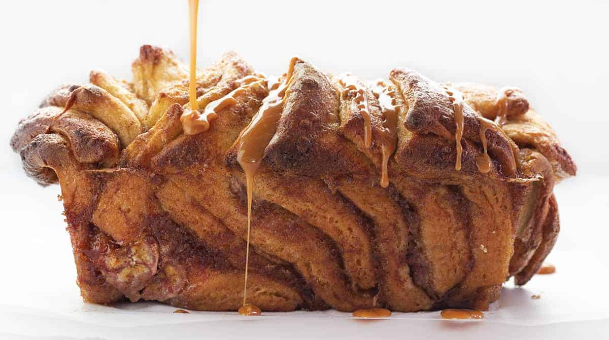 Drizzling Caramel over Bananas Foster Pull-Apart Bread