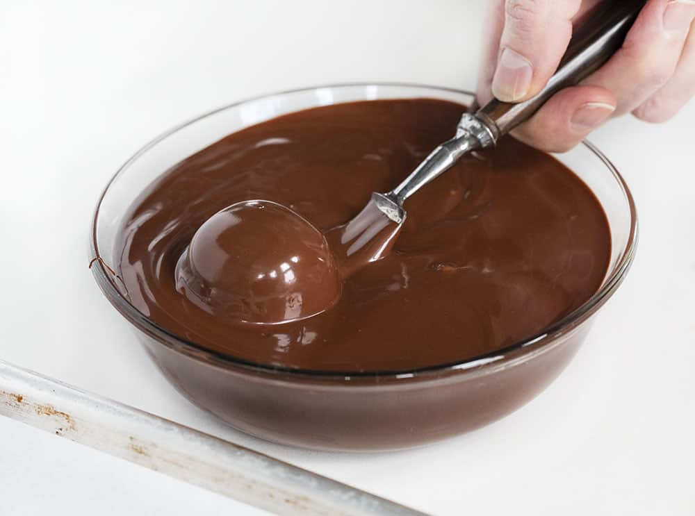 Dipping Buttercream Candy into Chocolate