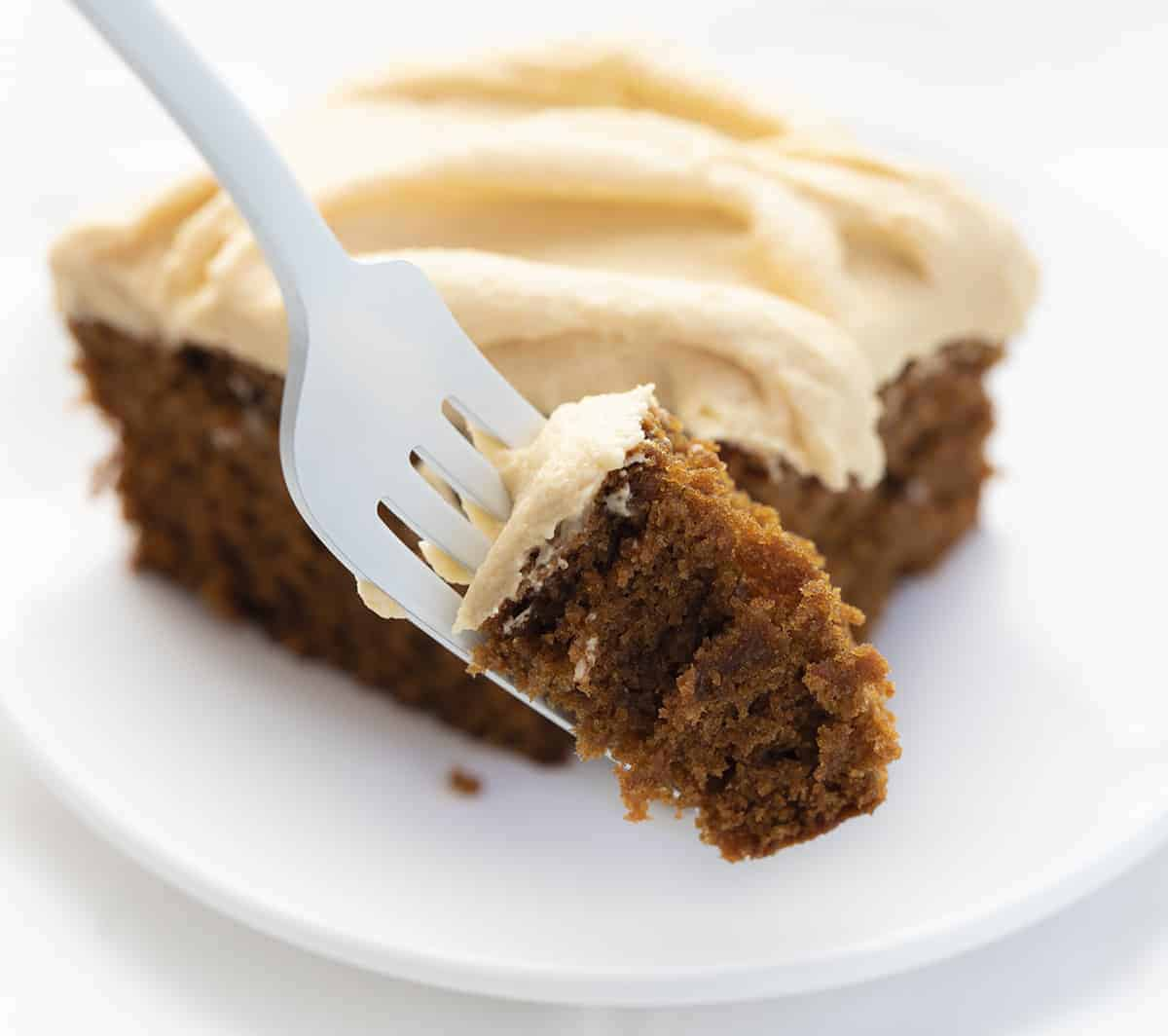 Fork with Bite of Gingerbread Cake with Salted Caramel Frosting
