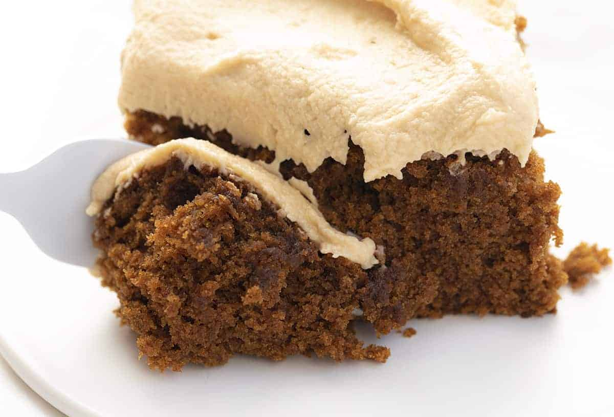 Fork Taking a Bite of Gingerbread Cake with Salted Caramel Frosting