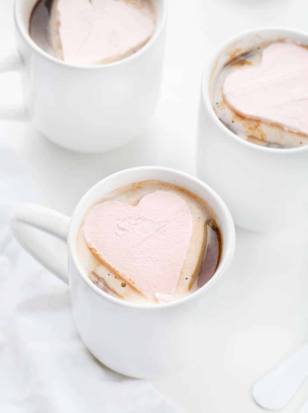 Pink Whipped Cream Hearts in Cups of Hot Cocoa