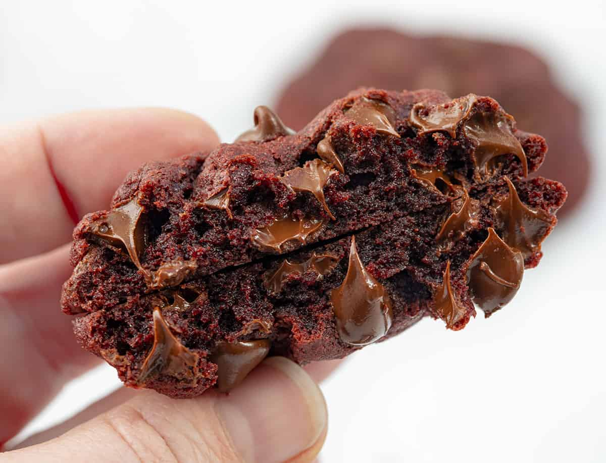 Hand Holding Red Velvet Chocolate Chip Cookies