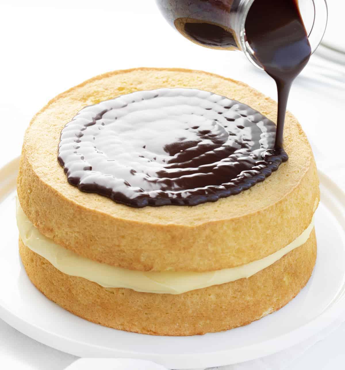 Pouring Chocolate over Boston Cream Pie
