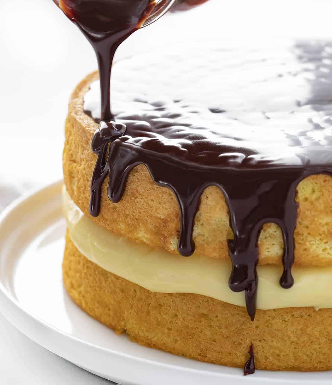 Poring Chocolate Over Boston Cream Pie