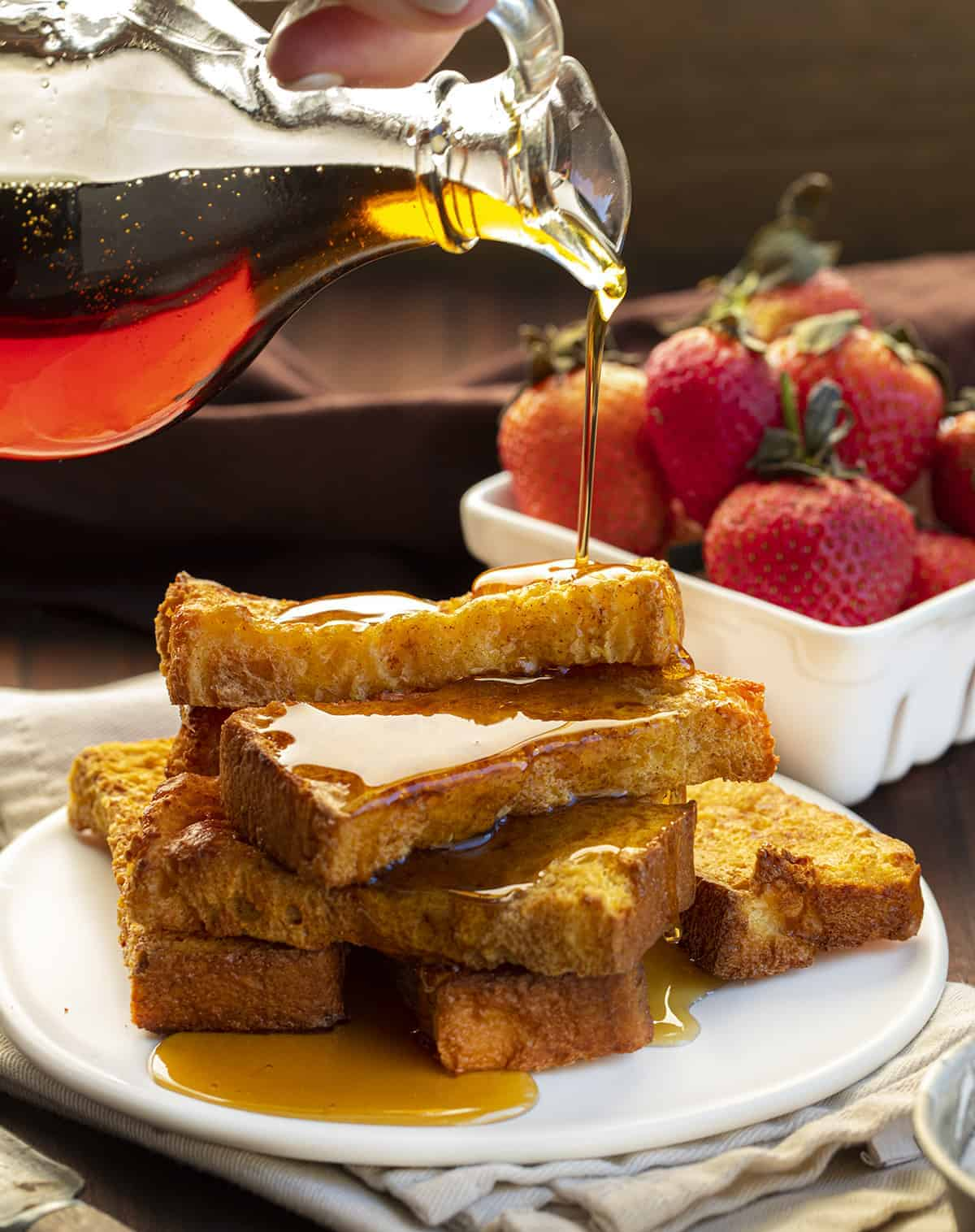 Pouring Syrup over Air Fryer French Toast Sticks