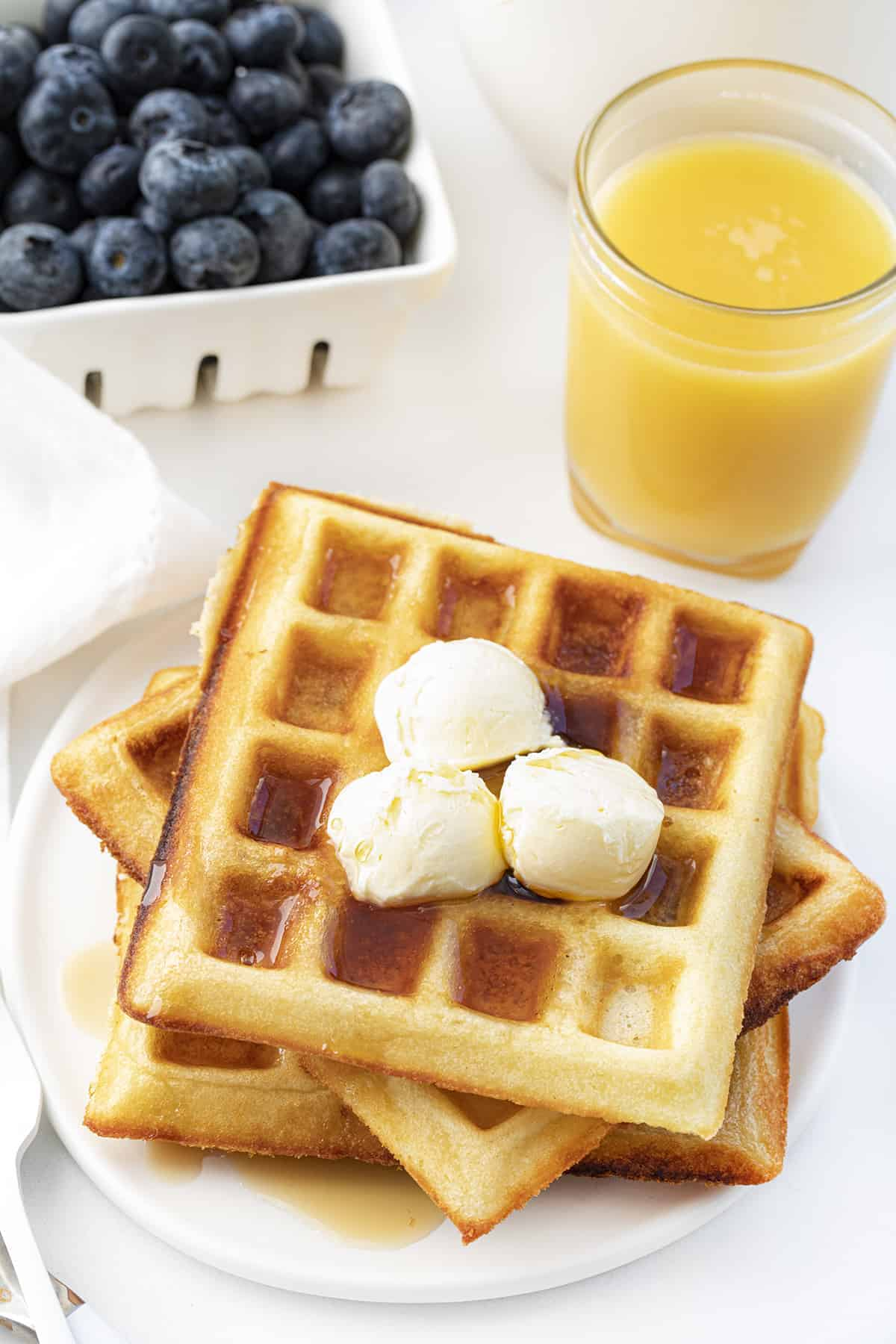 Waffles of Insane Greatness on Plate with Fruit and Butter