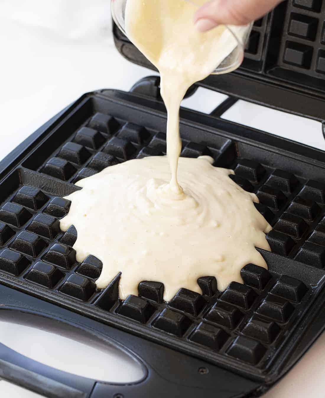 Pouring Waffle Batter on Waffle Iron