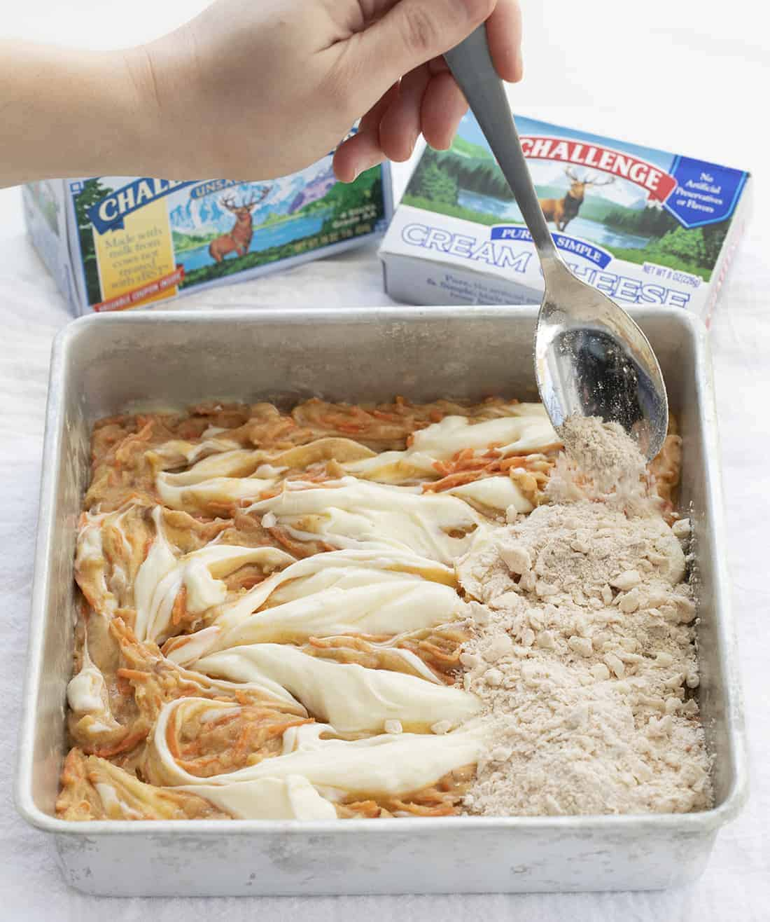 Carrot Cake Bars Being Made in Pan with Challenge Butter Box