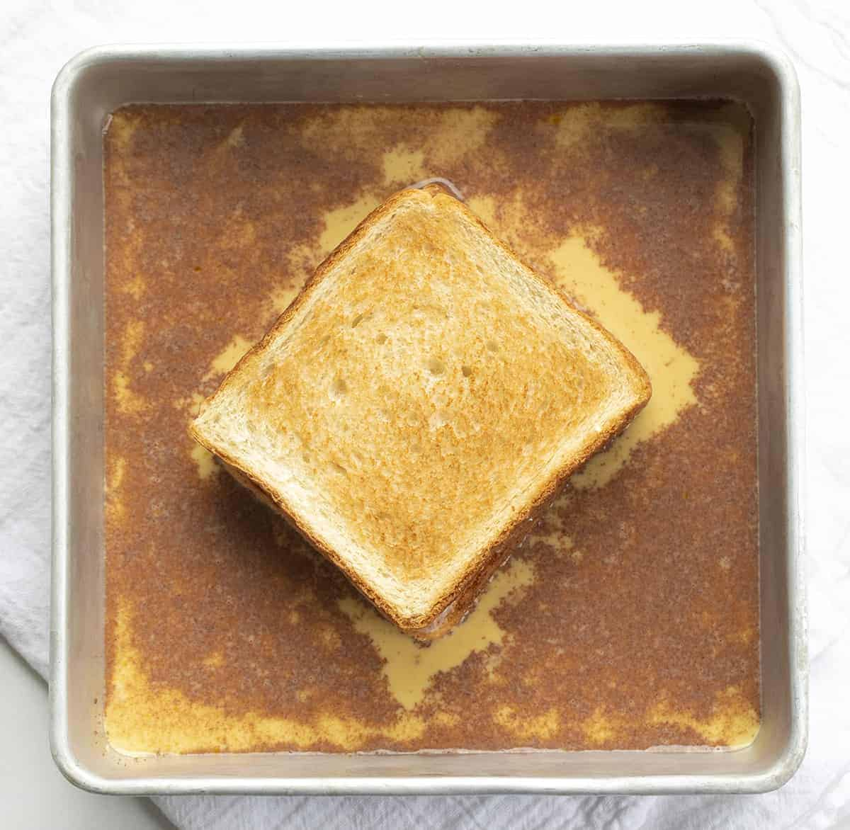 Adding Stuffed French Toast to Egg Mixture