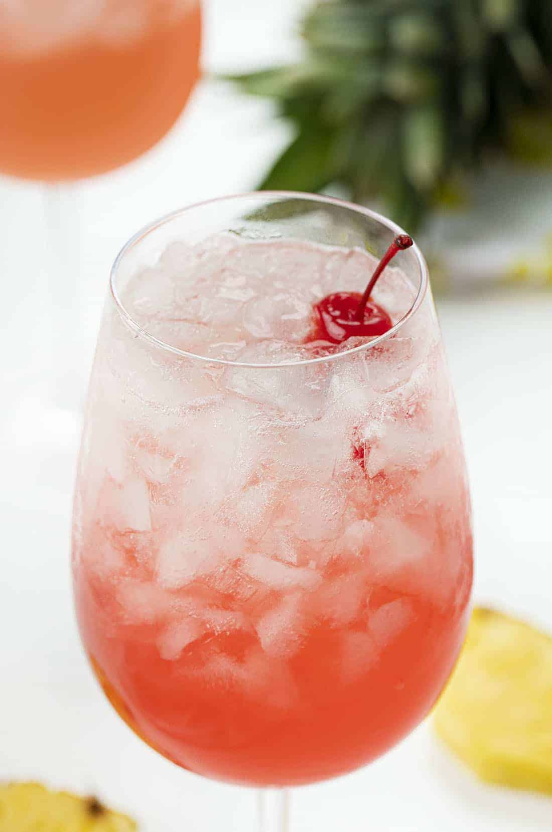 Tropical Champagne Cocktail with Cherries