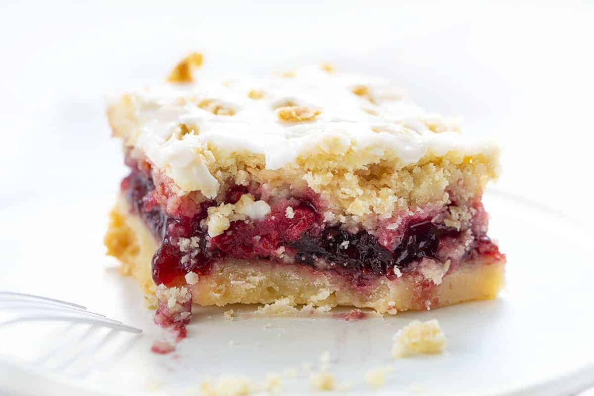 Raspberry Oatmeal Bar with Bite Missing and Fork