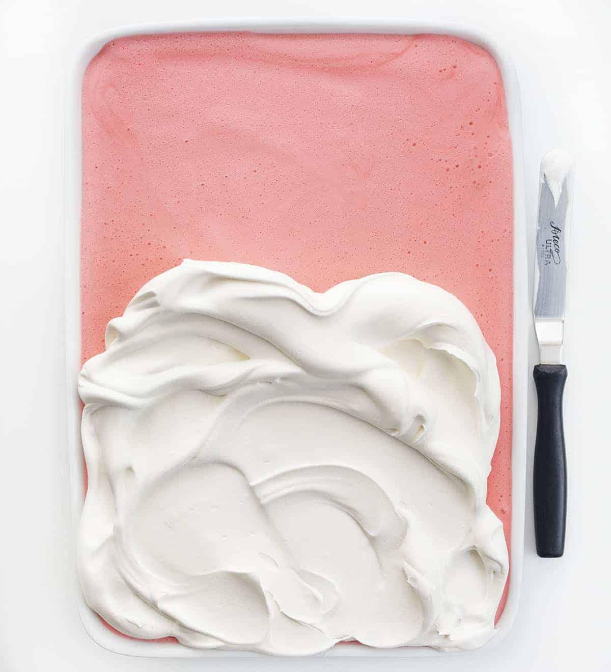 Adding Whipped Cream to Strawberry Icebox Cheesecake