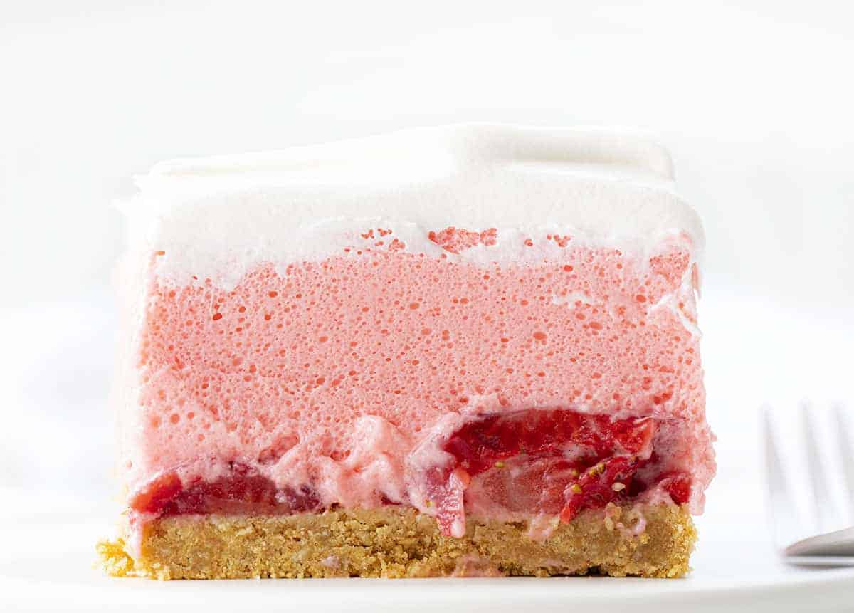 Piece of Strawberry Icebox Cheesecake on a Plate with Fork