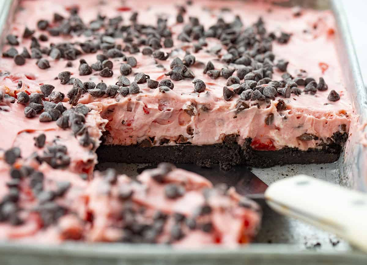 Chocolate Cherry Pie Bars in a Pan with Spatula