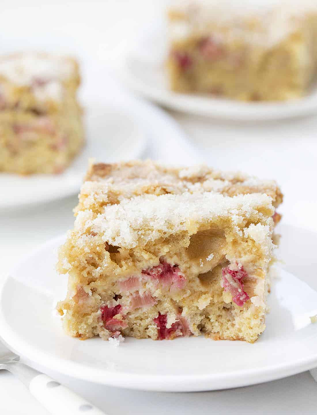 Pieces of Rhubarb Cake on White Plates