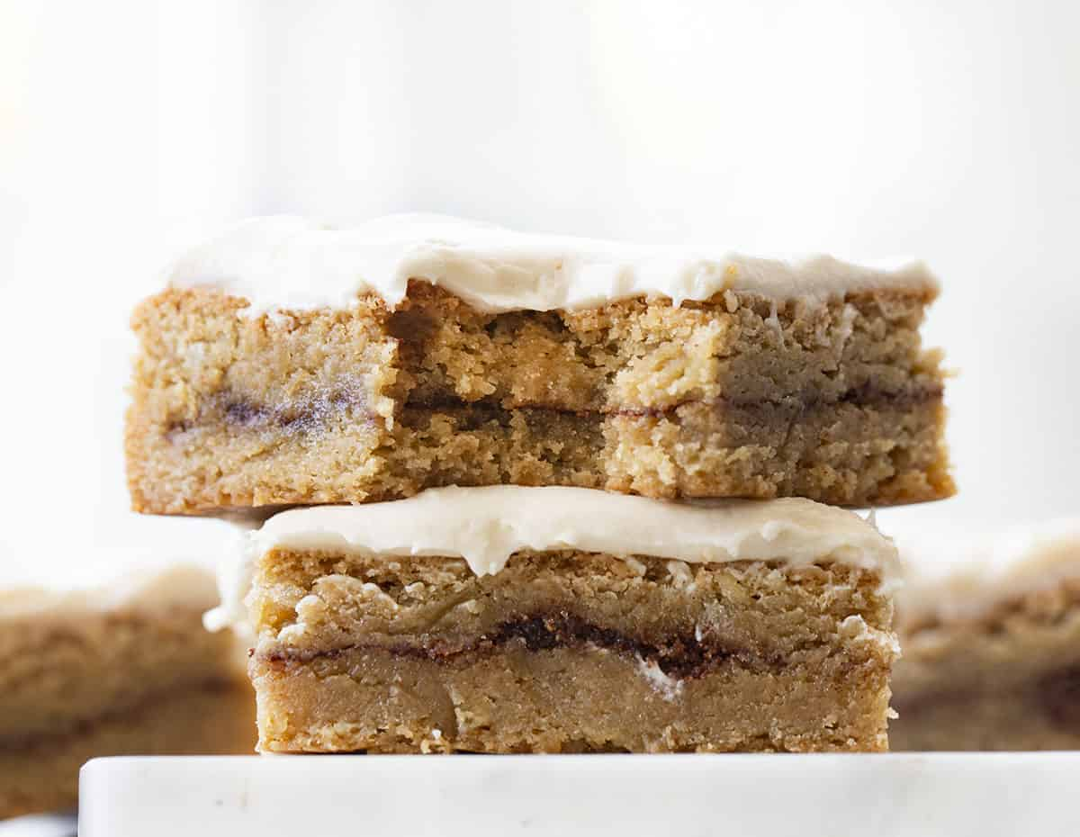 Stacked Cinnamon Roll Blondies Topped with Cream Cheese Frosting