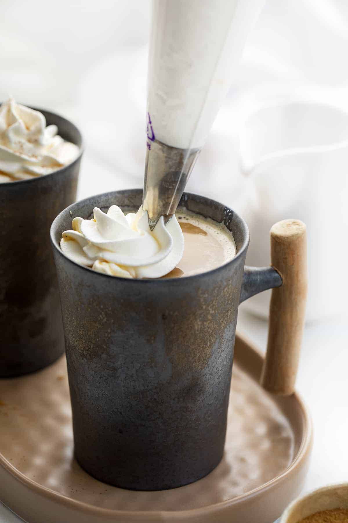 Adding Whipped Cream to Pumpkin Spice Latte